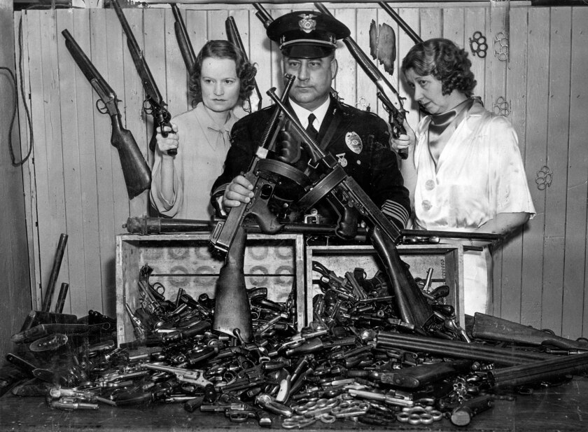 July 18, 1935: Los Angeles policewoman Mona Rehling, left, Chief of Police James Davis and policewom