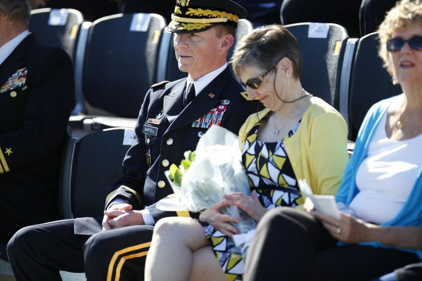 Major General Arthur Bartell (left) assumed command of the Army and Navy academy in Carlsbad. The change of command comes after a sexual assault scandal that hit the school under Brigadier General Stephen Bliss. General Bartell and his wife Karen Bartell (right) were presented with flowers from cad