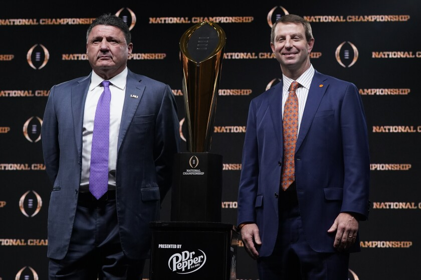 Louisiana State coach Ed Orgeron and Clemson coach Dabo Swinney, right, will go head to head on Monday in the College Football Playoff National Championship Game.