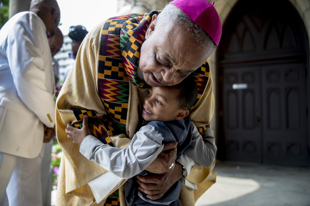 Archbishop of Washington Wilton Gregory hugs Noah Tanner, 4, at St. Augustine Catholic Church in June 2019.