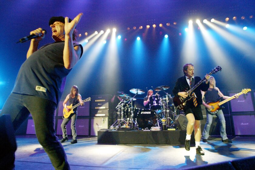 FILE - This June 17, 2003 file photo shows British rock band AC/DC, from left, Brian Johnson, Malcolm Young, Phil Rudd, Angus Young, and Cliff Williams performing on stage during a concert in Munich, southern Germany. Young says his band mates have not been in touch with Rudd since he was charged with threatening to kill and possessing methamphetamine and marijuana last week. Young, 59, said in an interview Thursday, Nov. 13, 2014, that Rudd's behavior had been somewhat erratic during the recording of their new album. (AP Photo/Jan Pitman, File)