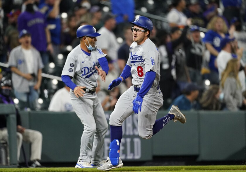 The Dodgers' Zach McKinstry, right, runs around third base on the way to notching an inside-the-park home run April 3, 2021.