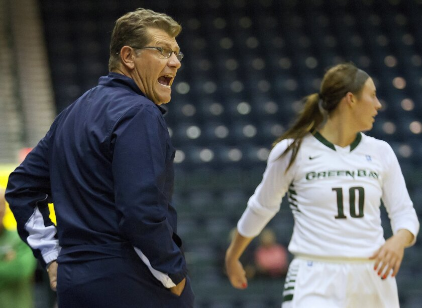 Connecticut head coach Geno Auriemma argues with an official during an NCAA college basketball game against Green Bay on Sunday, Nov. 30, 2014, in Estero, Fla. (AP Photo/The News-Press, Gabby Jones)