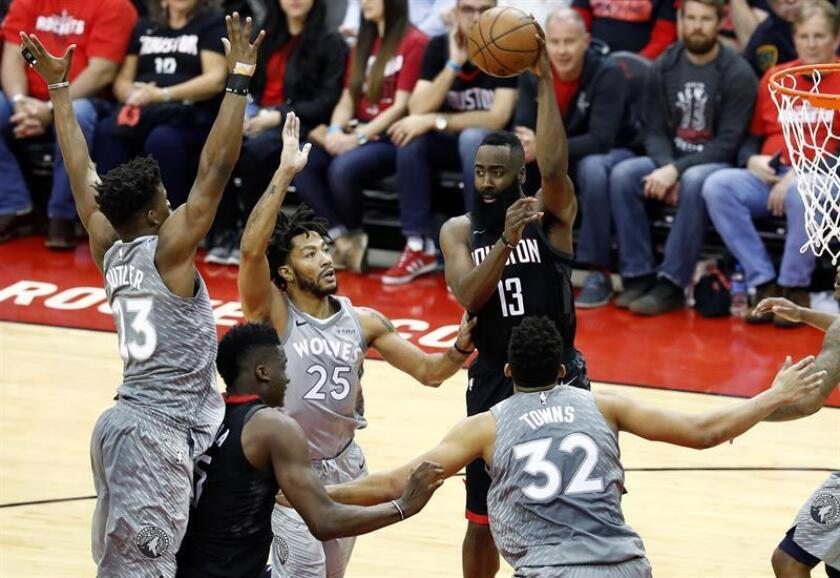 Houston Rockets guard James Harden (R) passes the ball against the Minnesota Timberwolves in the second half of the NBA Western Conference first round Playoffs basketball game between the Minnesota Timberwolves and the Houston Rockets at the Toyota Center in Houston, Texas, USA, 15 April 2018. EFE