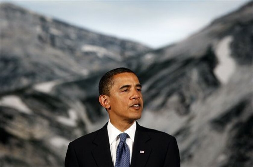 FILE - In this July 9, 2009 file photo, President Barack Obama speaks about climate change during the G8 Summit in L'Aquila, Italy. A poll released Friday and conducted in the five major European powers, France, Germany, Italy, Great Britain, Spain, showed that Obama has retained the support of the vast majority of the Europeans polled, even as his rating sagged in the U.S. (AP Photo/Haraz N. Ghanbari, File)
