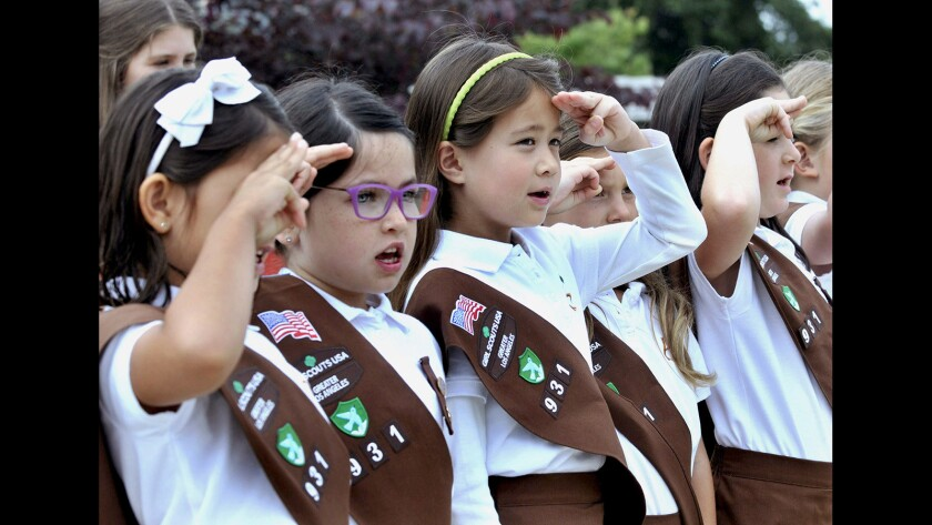 "Brownie Scouts from Troop 931 lead the Pledge of Allegiance for Memorial Day services in 2016. Writer Joe Puglia, who has organized the service for several years, writes in his final Valley Sun column that ""La Cañada is a kaleidoscope full of stories."""