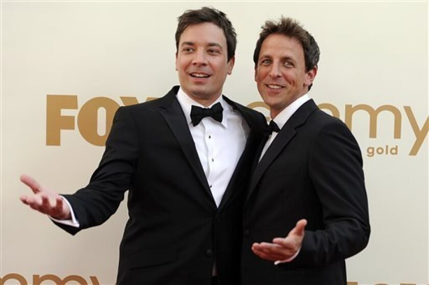 """FILE This Sept. 18, 2011 file photo shows Jimmy Fallon, left, and Seth Meyers at the 63rd Primetime Emmy Awards in Los Angeles. Meyers is moving from his """"Weekend Update"""" desk to his own late night show on NBC. The network said Sunday, May 12, 2013 that the longtime """"Saturday Night Live"""" cast member will replace Jimmy Fallon at the 12:35 a.m. """"Late Night"""" show. Fallon will be moving up an hour as Jay Leno's replacement on the """"Tonight"""" show. (AP Photo/Chris Pizzello, file)"""