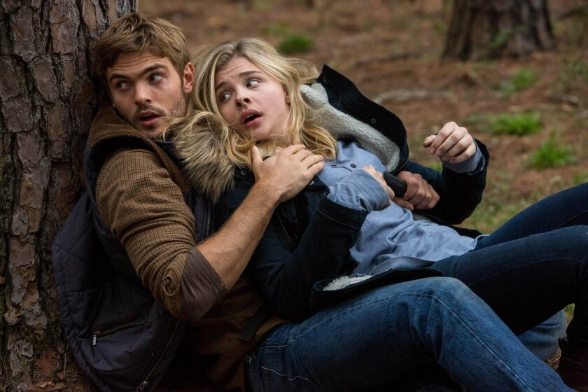 """This photo provided by Sony Pictures Entertainment shows, Alex Roe, left, as Evan Walker and Chloe Grace Moretz as Cassie Sullivan in a scene from the Columbia Pictures release, """"The 5th Wave."""" The movie opens in U.S. theaters on Jan. 22, 2016. (Chuck Zlotnick/Sony/Columbia Pictures via AP)"""