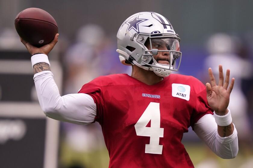 Dallas Cowboys quarterback Dak Prescott (4) passes during an NFL training camp football practice in Frisco, Texas, Thursday, Sept. 3, 2020. (AP Photo/LM Otero)