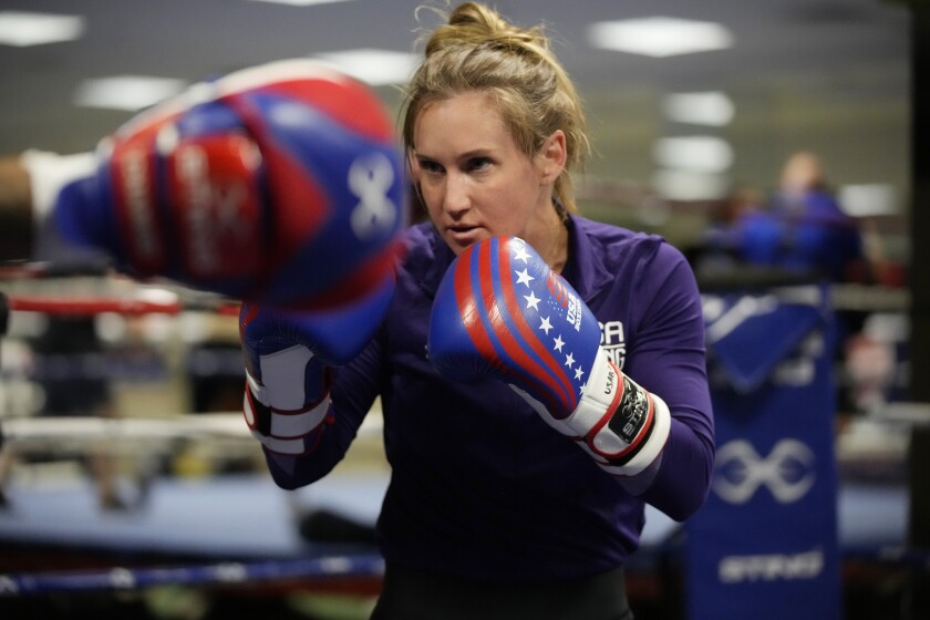 FILE - USA Boxing team member Ginny Fuchs takes part in drills during media day for the team in a gym located in a converted Macy's Department store in Colorado Springs, Colo., in this Monday, June 7, 2021, file photo. Fuchs' obsessive-compulsive disorder sometimes compels her to use a dozen toothbrushes a night and to buy hundreds of dollars of cleaning products per week. Yet Fuchs is headed to Tokyo next week to compete in the Olympic boxing tournament, where she realizes it's almost impossible to avoid touching the blood, sweat and spit of her opponents.(AP Photo/David Zalubowski, File)