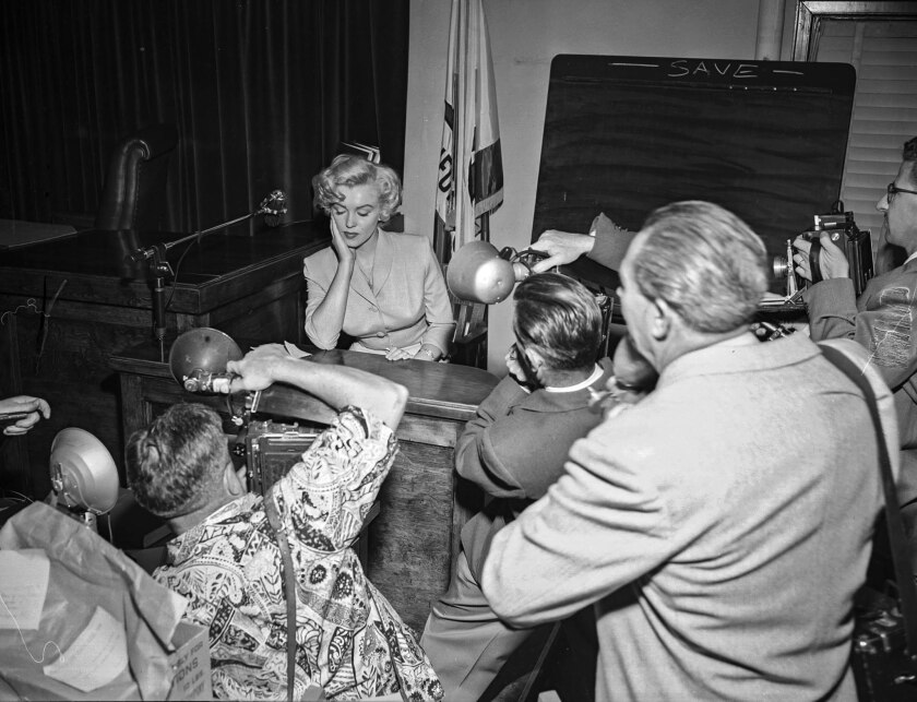 June 26, 1952: Marilyn Monroe posing for photographers during trial against Jerry Karpman and Morrie