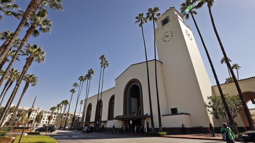 Passengers pass through the historic Union Station in Los Angeles, which is a carefree three-hour Amtrak train ride from downtown San Diego's Santa Fe Depot.