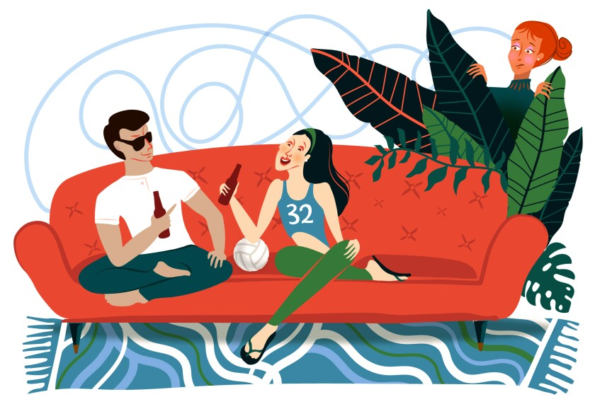 A man sits on a couch chatting up a woman -- while another woman looks on from behind plants.