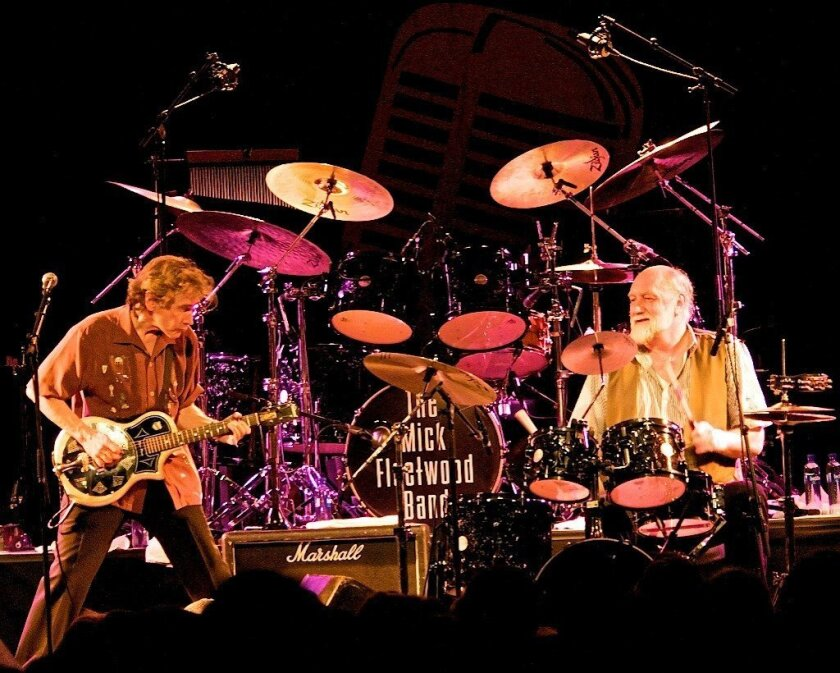 Guitarist Rick Vito and drummer Mick Fleetwood are shown in concert.