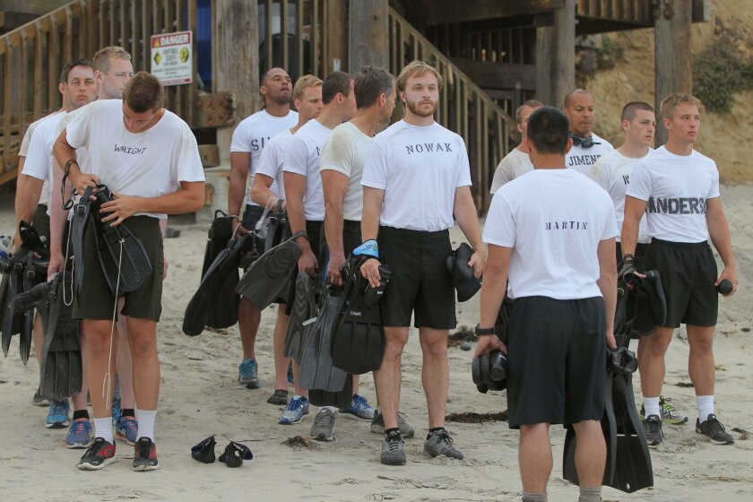 Students at the SEALFit Training Center assemble early in the morning on the beach at the end of D Street in Encinitas for water training.