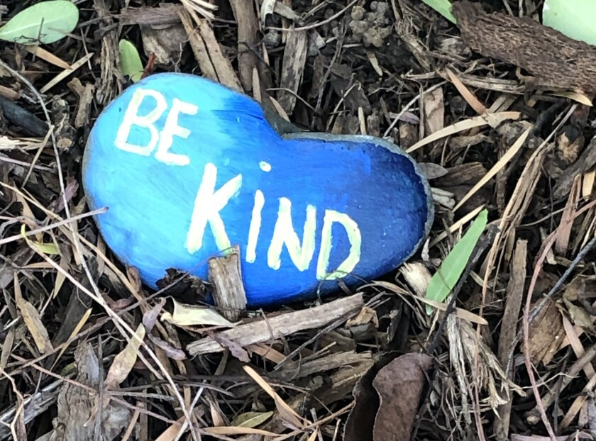 """A rock with a """"be kind"""" message painted on it."""