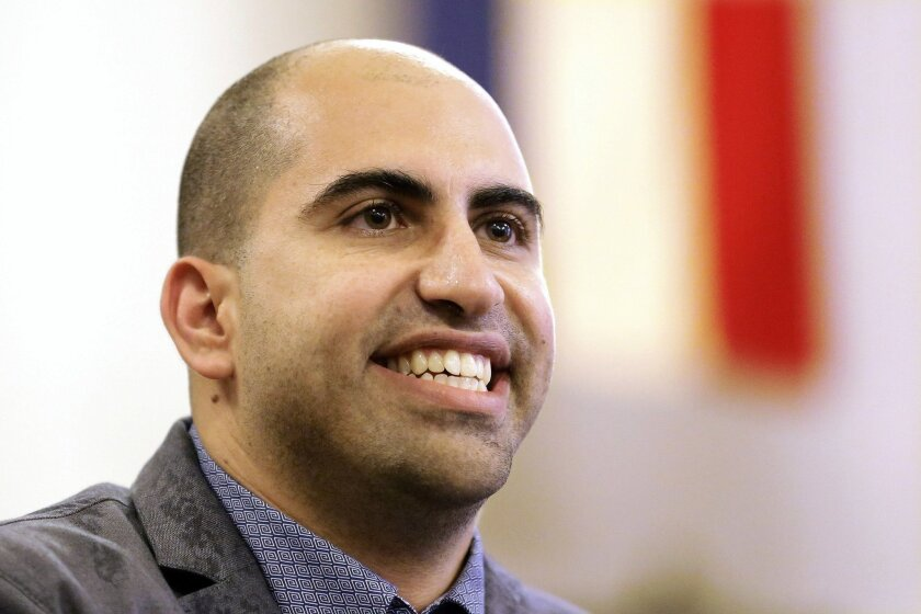 One step closer to vindication? Steven Salaita, a professor who lost a job offer from the University of Illinois over anti-Israel Twitter messages, speaks during a news conference in Champaign, Ill., on Sept. 9, 2014.