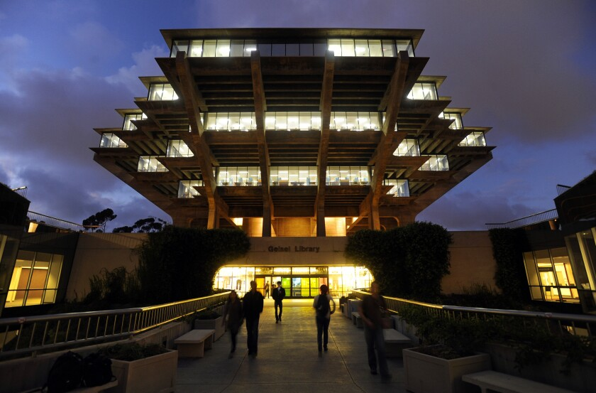People walked to and from UC San Diego's Geisel Library, which was lit on a November night in 2010.