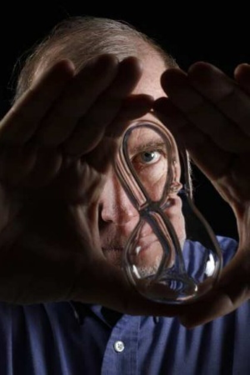 """Kevin Kelly, co-founder of Wired magazine, says that a Klein bottle """"reminds me of the essence of life and mind. The bottle circles back to itself in the same way that DNA self-organized into life, and the same way that a mind circles back to itself to produce consciousness. All are strange loops."""" (Rick Loomis / Los Angeles Times)"""