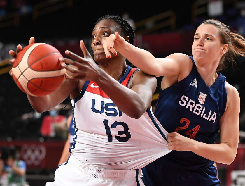 United States center Sylvia Fowles is pressured by Serbia's Maja Skoric.