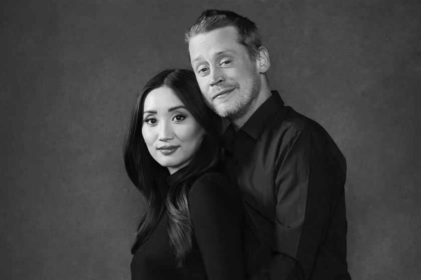 A black-and-white portrait of Brenda Song and Macaulay Culkin