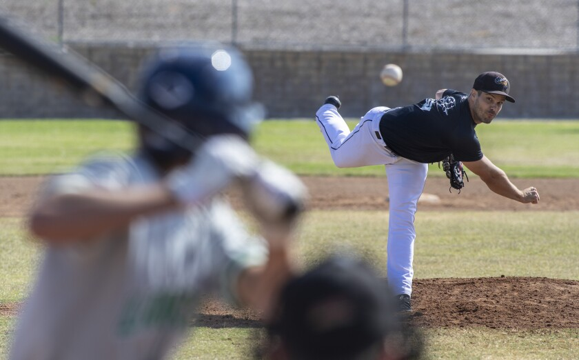 Jeff Johnson pitches during a scrimmage in Thousand Oaks to prepare for an independent league season.
