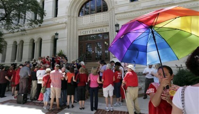 Faith leaders who support a proposed non-discrimination ordinance gather on the steps of City Hall, Tuesday, Sept. 3, 2013, in San Antonio. The San Antonio city council will vote Thursday on the ordinance which in part would prohibit discrimination based on sexual orientation and gender identity. (AP Photo/Eric Gay)