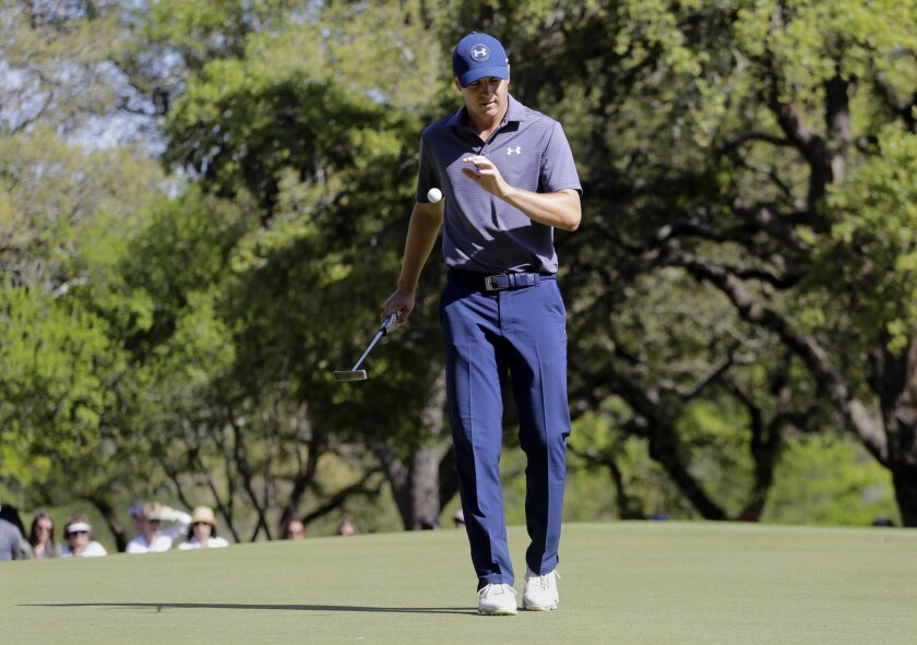 Jordan Spieth reacts after missing a putt on the sixth green during round-robin play against Justin Thomas at the Dell Match Play Championship golf tournament at Austin County Club, Friday, March 25, 2016, in Austin, Texas. (AP Photo/Eric Gay)