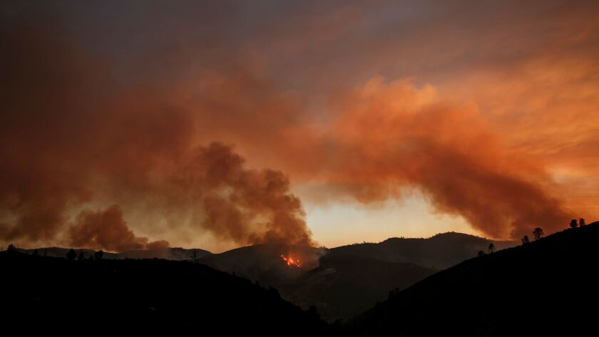 COULTERVILLE, CALIF. -- THURSDAY, JULY 20, 2017: Plumes of smoke rises as the northern front of the