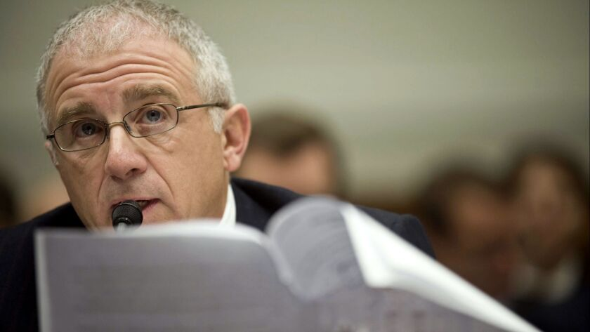 Ticketmaster Entertainment Chief Executive Officer Irving Azoff reads his opening statement on Capitol Hill as he testified before the House Courts and Competition Policy subcommittee on Feb. 26, 2009.