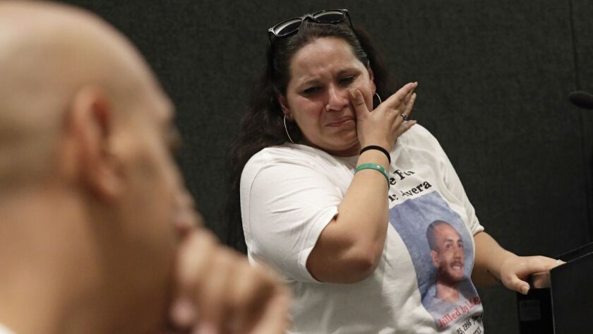 Valerie Rivera, the mother of Eric Rivera, sobs after addressing the L.A. Police Commission. Eric Rivera died last summer after he was shot by officers, then run over by their uncontrolled patrol car.