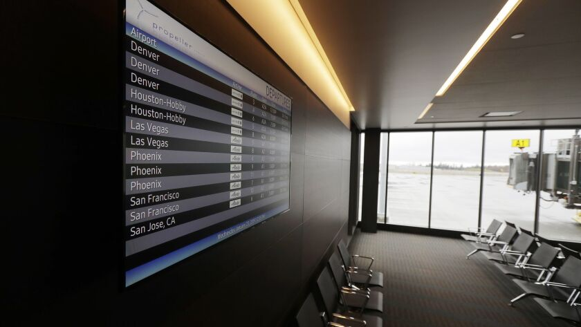 A flight status video display at the new passenger terminal at Paine Field in Everett, Wash.