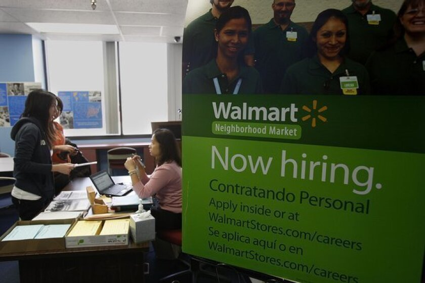 Wal-Mart has been taking applications for a new story it's planning in Chinatown, but a slump in overall sales could lead to a slowdown in hiring for the retailer.