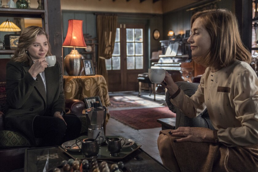 This image released by Focus Features shows Chloë Grace Moretz, left, and Isabelle Huppert in a scen