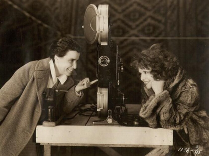 """Director Dorothy Arzner is shown with actress Clara Bow during the filming of 1929's """"The Wild Party."""""""