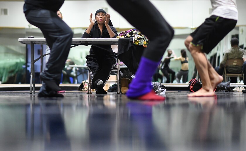 Lula Washington, seated, observes a rehearsal of her namesake dance company.