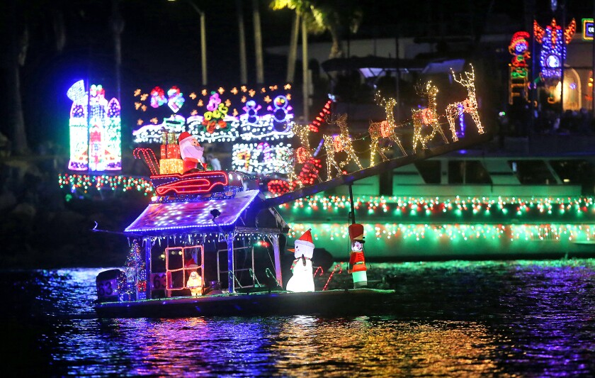 A small boat with a big Santa theme, moves along the route.