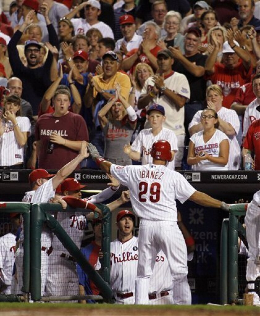 Philadelphia Phillies' Raul Ibanez celebrates with his teammates after he hit a solo home run against the Atlanta Braves in the second inning of a baseball game Wednesday, Sept. 7, 2011, in Philadelphia. (AP Photo/H. Rumph Jr)