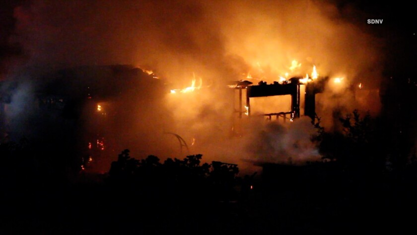 Fire rips through a home on Camino Privado in Rancho Santa Fe on Friday night.