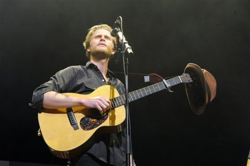 """FILE - This Dec. 8, 2012 file photo shows Wesley Schultz of The Lumineers performing at KROQ Almost Acoustic Christmas in Los Angeles. The Lumineers', """"Ho Hey"""" was the top streamed track on Spotify for the week of Dec. 3. (Photo by Katy Winn/Invision/AP, file)"""