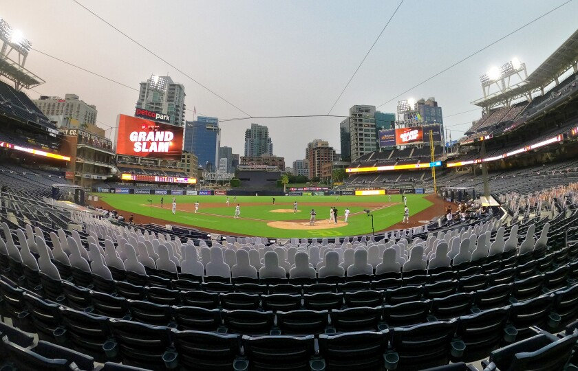Cardboard cutouts remain seated as Padres' Wil Myers rounds bases following a grand slam Tuesday night at Petco Park.