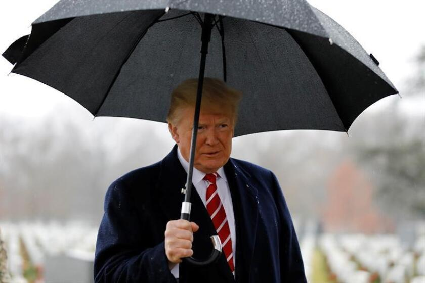 US President Donald J. Trump visits Section 60 at Arlington National Cemetery in Arlington, Virginia, USA, on Dec. 15, 2018. Section 60, is the burial ground in the cemetery where military personnel killed in the Global War on Terror since 2001 are interred. EFE/EPA/YURI GRIPAS /POOL/FILE