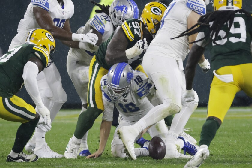 Detroit Lions' Jared Goff fumbles during the second half of an NFL football game against the Green Bay Packers Monday, Sept. 20, 2021, in Green Bay, Wis. (AP Photo/Mike Roemer)