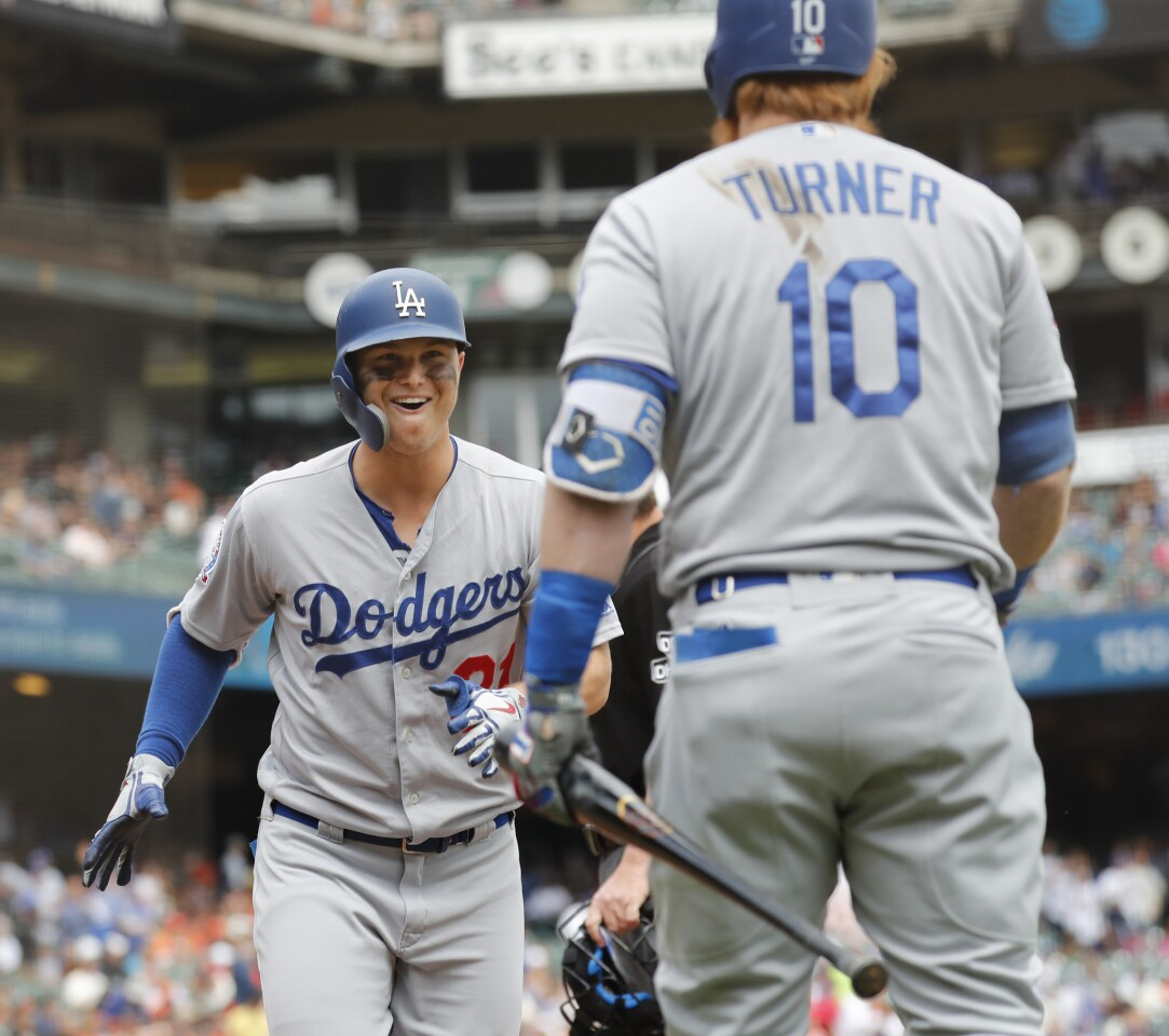 Los Angeles Dodgers' Joc Pederson (31) celebrates scoring a home run with Justin Turner (10) during the first inning of a baseball game in San Francisco, Saturday, Sept. 29, 2018. (AP Photo/Jim Gensheimer)