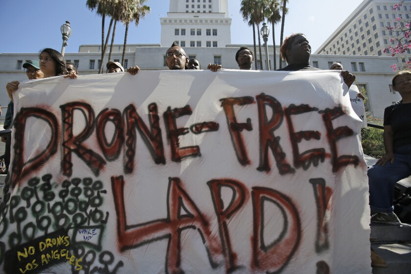 Mario Bautista, middle, along with other members of Stop LAPD Spying Coalition, holds a press conference outside Los Angeles City Hall in downtown Los Angeles.