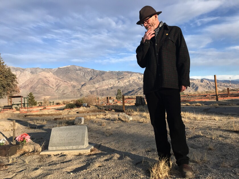 Allen Berrey visits the grave site of Jose C. Pires at Mt. Whitney Cemetery in Lone Pine, Calif.