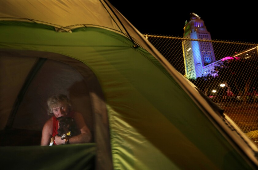 Homeless woman camps near Grand Park in downtown L.A.