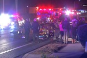 Motorcycle rider seriously injured in crash into sedan