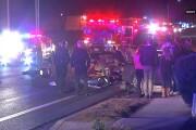 Motorcycle rider seriously injured in crash into sedan
