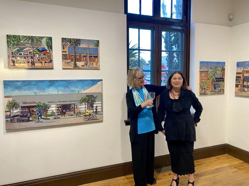 "Paula McColl (left) and Athenaeum Executive Director Erika Torri attend the opening of ""Paula McColl: Celebrating La Jolla."""